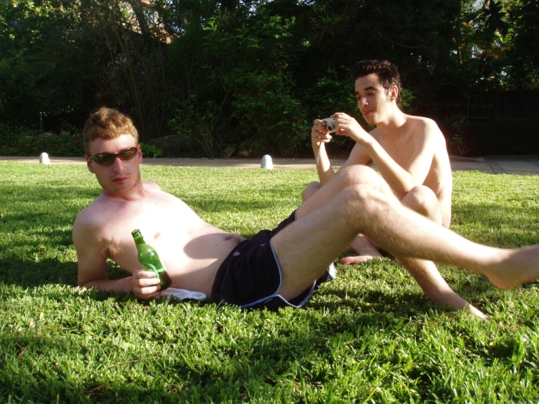 shirtless dudes in the park